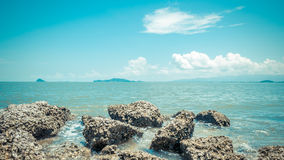 Beach and sea with blue sky and reef rock beach Royalty Free Stock Images