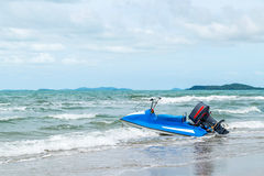 Beach and sea with blue sky and water scooter boat Royalty Free Stock Photo