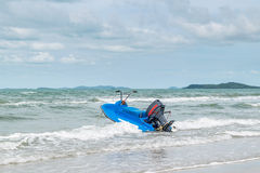 Beach and sea with blue sky and water scooter boat Stock Photos