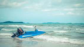 Beach and sea with blue sky and water scooter boat Stock Photography