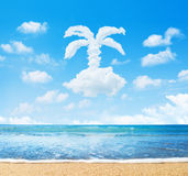 Beach and sea. Cloud in form of palm tree. In blue sky Stock Photography