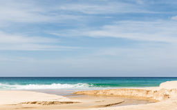 Beach, sea and cloudy blue sky Royalty Free Stock Photo
