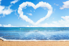 Beach and sea. Heart of clouds on sky Royalty Free Stock Photography