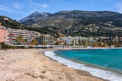 Beach and Sea in Menton Town on French Riviera. Beach in Menton sea town in France, resort on French Riviera - Cote dAzur, Alpes Maritimes Royalty Free Stock Image