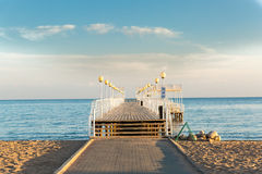 Beach at sea with pier Stock Images