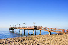 Beach Sea and Pier in Marbella Stock Photo