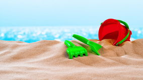 On the Beach / By the Sea - sand toys on a sand dune in front of beautiful azure sea on a sunny day - seamless loop - ProRes stock footage