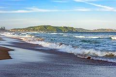 Beach. Sea and sand of Tucuns beach in Buzios with the beach Geriba the background Stock Photos