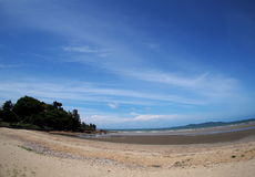 Beach sea scene view with deep blue sky and brown beach sand and stones Royalty Free Stock Photography