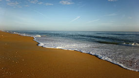 Beach with Sea Shore Line and Warm Sand Royalty Free Stock Image