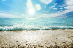 Beach sea and sky with clouds. And sun Stock Photo