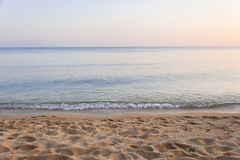 Beach, Sea, Sky. Photo of a sandy beach  in Kavala, Greece, with sky, sand and sea, each taking one third of the image Stock Photo