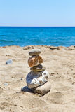 Beach and sea. Stones stacked tower royalty free stock photo