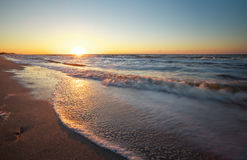 Beach and sea at sunrise. Royalty Free Stock Image