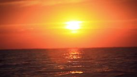 Beach and sea sunset.  Changes focus from. Foreground to background with bokeh. HD. 1920x1080 stock footage