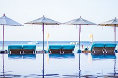 Beach and sea swimming pool With umbrellas and sun loungers At the island in Thailand royalty free stock photo