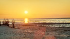 Beach Sea View At Sunset. With Mud Flat In Background Stock Photos