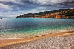 Beach and Sea in Villefranche Sur Mer on French Riviera Royalty Free Stock Photography