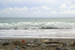 Beach and sea. Sea, beach and waves with cloudy sky Royalty Free Stock Photography
