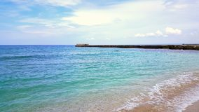 Beach sea waves. Fantastically beautiful blue-green sea and golden beach Stock Images
