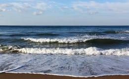 Beach and sea. Waves wash over sand on Sea beach Stock Photos
