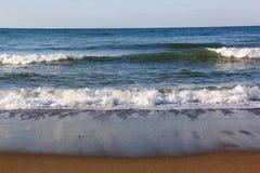 Beach and sea. Waves wash over sand on Black Sea beach Stock Photography