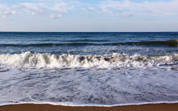 Beach and sea. Waves wash over sand on Black Sea Royalty Free Stock Photo