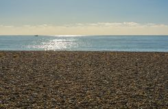 Beach and sea at Worthing, Sussex, England. Shingle beach and sea at Ferring near Worthing, West Sussex, England Stock Image