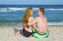 Beach ,sea  and young couple Stock Image