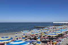 Beach of `Seagull` in the resort settlement Adler, Sochi, Krasnodar region, Russia. Adler, Sochi, Krasnodar region, Russia - July 13, 2016: Beach of `Seagull` in stock images