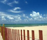 Beach seascape with sand fence. On shore of Lake Michigan stock photos