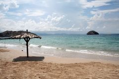 Beach seaside. Seaside beach with shade umbrella on an island in Venezuela Royalty Free Stock Photography