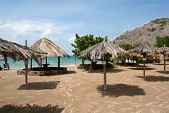 Beach seaside. Seaside beach with shade umbrella on an island in Venezuela Royalty Free Stock Photo