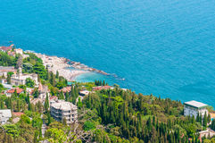 Beach at the seaside, blue water, view from above the mountains to the town of Simeiz, Yalta, Crimea royalty free stock image