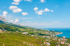 Beach at the seaside, blue water, view from above the mountains to the town of Simeiz, Yalta, Crimea royalty free stock photography