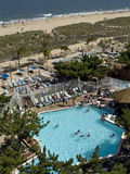 Beach and seaside pool. Overlooking a sandy beach and seaside pool Stock Photos