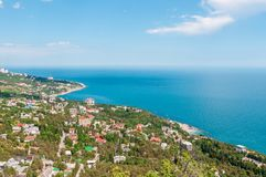 Beach at the seaside, blue water, view from above the mountains to the town of Simeiz, Yalta, Crimea royalty free stock images