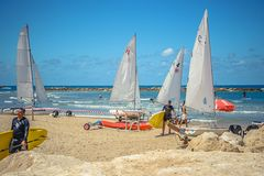 Landscape on a beautiful beach with yachts. Preparations. Stock Photos
