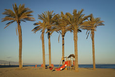 Playground on beach. Empty beach with palms and playground after season, Roquetas de Mar, Andalusia, Spain Stock Photo