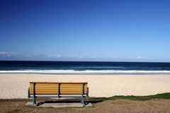 Beach Seat. An empty bench looking onto the beach, taken at surfers paradise, queensland, australia Stock Photos