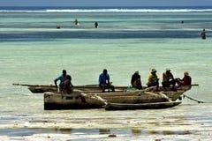 Beach seaweed people and boat in tanzania zanzibar Stock Photography