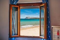 Beach seen through an open window Royalty Free Stock Image