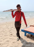 Beach seller boy of sunglasses on coastline Royalty Free Stock Photography