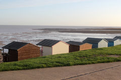 Beach Sentinels. This photo shows a row of beach huts on Tankerton Slopes in Whitstable Royalty Free Stock Photo