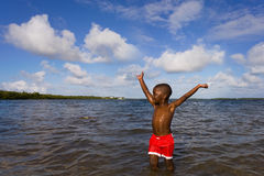Beach Series - Diversity. Small African American boy playing at the beach. John Pennecamp Park, Florida Keys Royalty Free Stock Photos