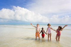 Beach Series - Diversity. Four small children of different races playing at the beach. Bahia Honda, Florida Keys Royalty Free Stock Photo
