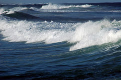 Beach Series: Small Waves. Small waves, blue ocean and foam Royalty Free Stock Photo