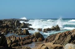 Beach Series: Waves crashing in. Small waves and rocks Royalty Free Stock Photography