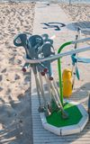 Group of crutches on the special walkway for disabled in the beach stock images