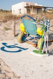 Wheelchair and crutches for the disabled with first aid station. Beach with services for people with reduced mobility in Menorca stock photos